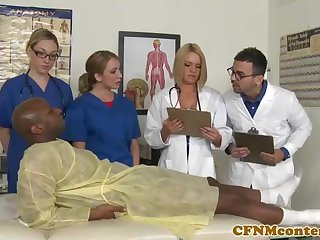 A kinky ebony patient is porking a saucy nurse who luvs with surging rock hard sausages