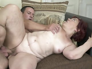 Red-haired granny to be sure gets her old twat banged hard