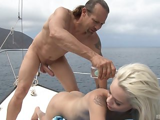 Petite anorectic blonde Elsa Jean deepthroats a long cock primarily a yacht