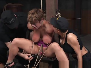 Bonded Busty Submissive Blushing At The Dungeon