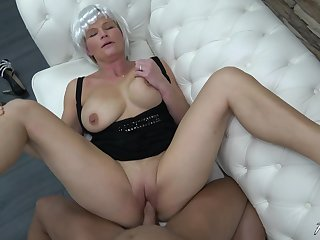 MILF uses her professional blowjob skills to make him finish