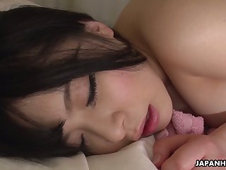 Entertaining Asian newborn Satomi Nagase is finger fucking shaved pussy
