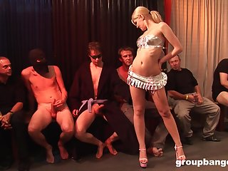 Oiled up blonde slut gets fucked apart from multiple dudes waiting in line