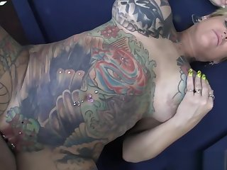 Mature Tattooed Blonde With Big Pair