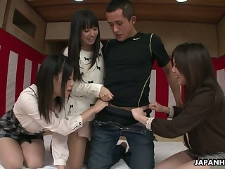 Duo Japanese girls gives a blowjob to one horny lady's man and get their pussies creampied