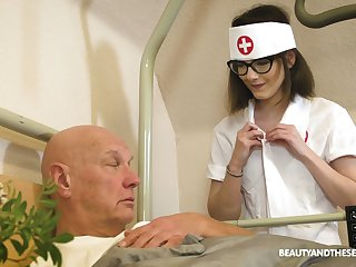 Cum-thirsty young nurse Sara Bell gives a blowjob to old covering