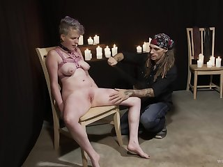 Rough torture session with candle expound makes a slave girl scream